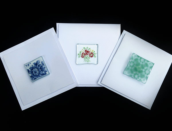 Cards-assorted-designs-Back-lower-edge-cut-away-to-allow-card-to-stand