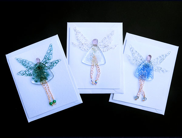 Fairy-cards-Made-from-assorted-crushed-bottles-and-crocheted-wire.-Back-lower-edge-cut-away-to-allow-card-to-stand
