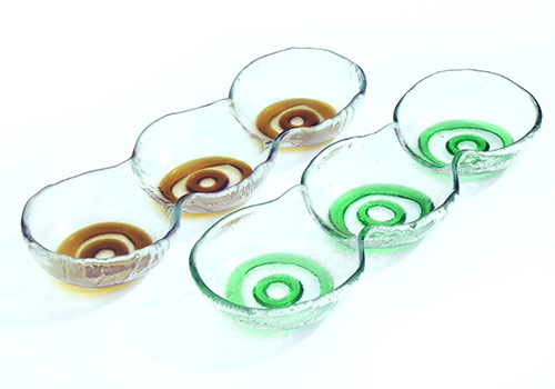 Linked-bowls-made-from-lager,-wine-bottles-and-window-glass